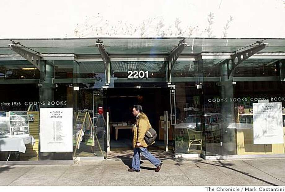 A pedestrian strolls past Cody's Books on Shattuck Ave. on Thursday, April 10, 2008 in Berkeley, Calif. Cody's has opened up its new store by the downtown Berkeley BART station.  Photo by Mark Costantini  /  San Francisco Chronicle. Photo: Mark Costantini, The Chronicle
