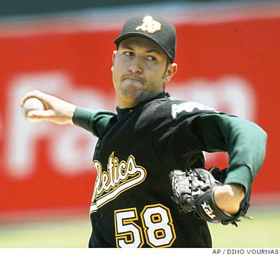 Oakland Athletics pitcher Justin Duchscherer throws to the Florida Marlins  in the first inning of an interleague baseball game, Sunday, June 22, 2008 in Oakland, Calif.  (AP Photo/Dino Vournas) Photo: DINO VOURNAS, AP