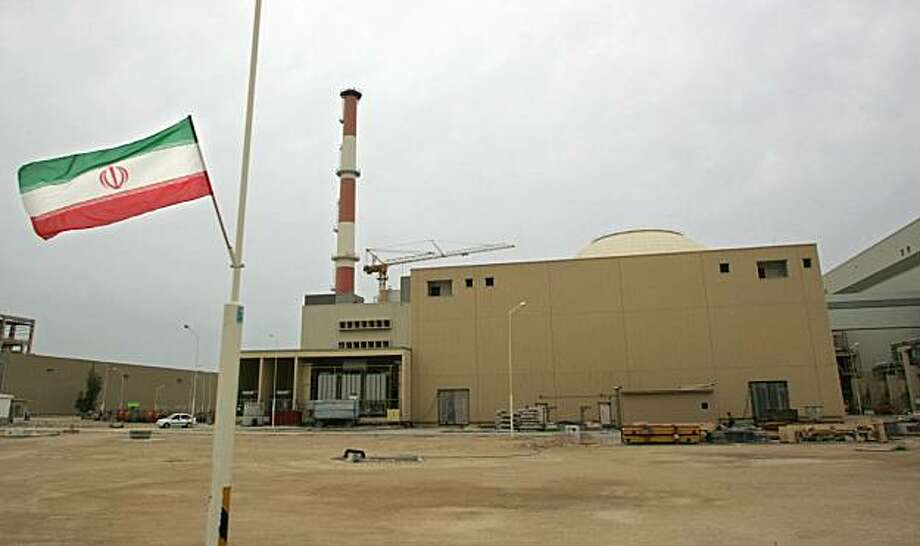 (FILES) -- File picture dated April 3, 2007 shows an Iranian flag outside the building housing the reactor of  the Bushehr nuclear power plant, being built by the Russians, in the southern Iranian port town of Bushehr, 1200 Kms south of Tehran. World powers threatened new sanctions against Iran on November 30, 2009 after Tehran defiantly pledged to build 10 more uranium enrichment plants, but Russia warned against further escalating the dispute. Iran's weekend vow to build the plants sparked strong reactions from the United States, Germany, Britain and France -- four of the six world powers negotiating with Tehran over its nuclear programme, as well as from the EU. AFP PHOTO/BEHROUZ MEHRI (Photo credit should read BEHROUZ MEHRI/AFP/Getty Images) Photo: Behrouz Mehri, AFP/Getty Images
