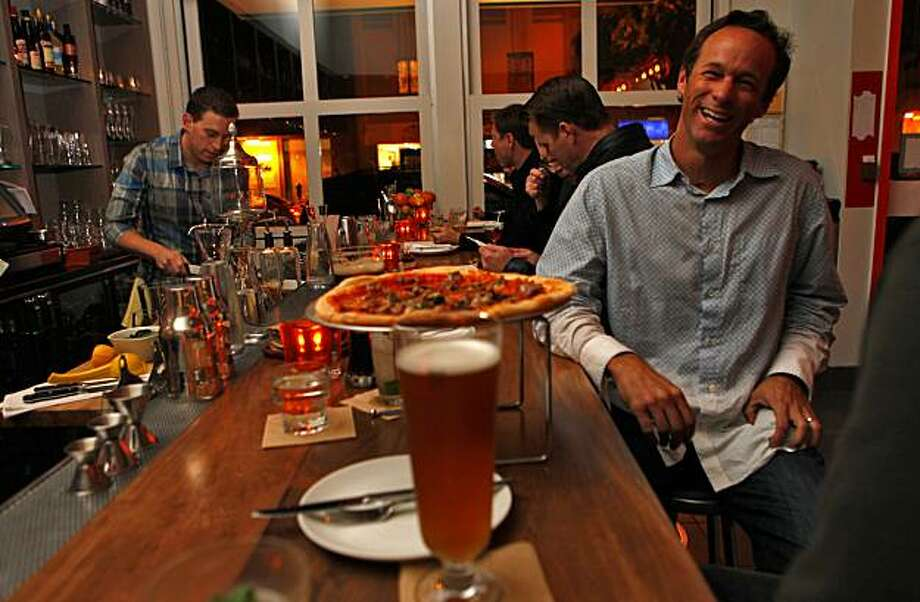 People enjoy pizzas and beer for dinner  at Delarosa,  Wednesday,  Dec. 2, 2009, in San Francisco,  Calif. Photo: Lacy Atkins, The Chronicle