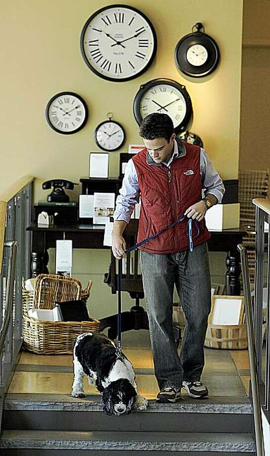 "Justin O'Neill of San Francisco shops with ""Geronimo"" at the Pottery Barn store in the Castro neighborhood on Friday October 30th in San Francisco, California. He created a new app for the iPhone called FidoFactor, which is like a Yelp for dogs. Photo: John Storey, Special To The Chronicle"