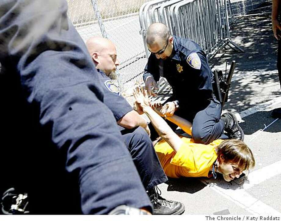 Berkeley University police arrest Matthew Taylor when he broke through their barricade on the Cal Berkeley campus as the tree sitters still remain in the trees and supporters attempt to bring them water and food, in Berkeley, Calif.  on Sunday,  June 22, 2008.Photo by Katy Raddatz / The Chronicle Photo: Katy Raddatz, The Chronicle