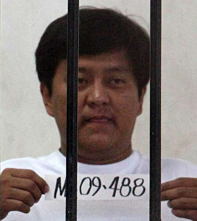 (FILES) File photo taken on November 26, 2009 shows the Philippines mayor of Datu Unsay, Andal Ampatuan Jr. behind bars at a National Bureau of Investigation detention cell in Manila. Philippine prosecutors on December 1, 2009 filed 25 counts of murder against the town mayor accused of leading the election-related massacre of 57 people, officials said. AFP PHOTO / FILES / NOEL CELIS (Photo credit should read NOEL CELIS/AFP/Getty Images) Photo: Noel Celis, AFP/Getty Images