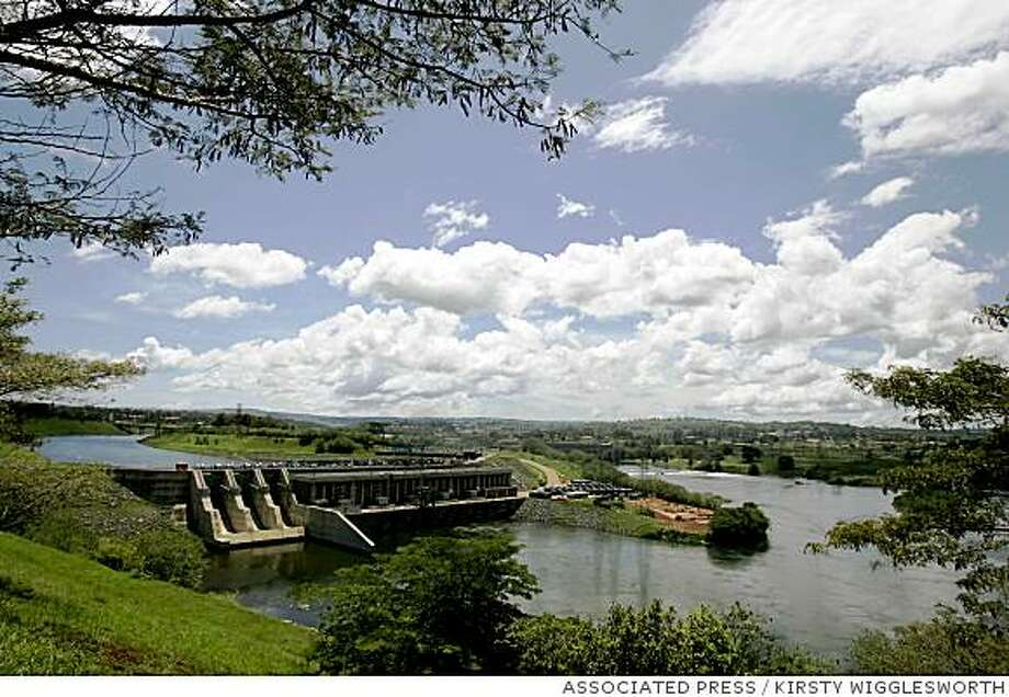 ** ADVANCE FOR SUNDAY, DEC. 10 ** The new Kiira Dam, left, runs  in parallel with Nalubaale Dam in Jinja, Uganda, Nov. 2, 2006. The two dams help generate electricity for Uganda, using water flowing from Lake Victoria, but they have been blamed by some people for the receding water levels in the lake.  (AP Photo/Kirsty Wigglesworth) Photo: KIRSTY WIGGLESWORTH, ASSOCIATED PRESS