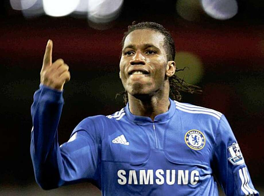 Chelsea's Didier Drogba celebrates after scoring the third goal of his team during an English Premier League soccer match against Arsenal at the Emirates stadium, London, Sunday Nov. 29,  2009. Chelsea won the match 3-0 with two goals by Drogba. (AP Photo/Lefteris Pitarakis) ** NO INTERNET/MOBILE USAGE WITHOUT FOOTBALL ASSOCIATION PREMIER LEAGUE (FAPL) LICENCE - CALL +44 (0)20 7864 9121 or EMAIL info@football-dataco.com FOR DETAILS ** Photo: Lefteris Pitarakis, AP