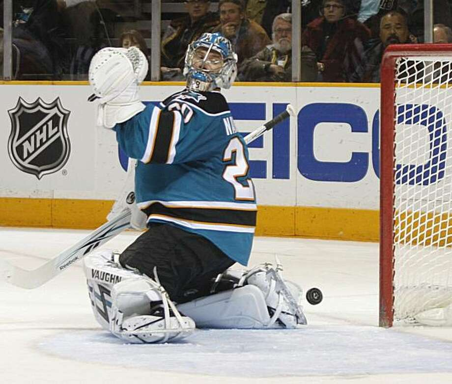 San Jose Sharks' goalie Evgeni Nabokov looks back after Calgary Flames Olli Jakonin scored a goal in the second period of an NHL hockey game, Saturday, Dec. 5, 2009 in San Jose, Calif. (AP Photo/George Nikitin) Photo: George Nikitin, AP