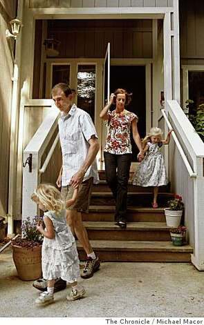Mike and Sarah Northrop at their Pacifica, Calif. home with their daughters Sylvanna, 4, with dad, and Nerea, 2, with mom, on June 13, 2008. After renting a home in San Francisco for seven years the family moved to Pacifica because they couldn't find a home they could afford to buy with enough room for the four of them.Photo By Michael Macor/ The Chronicle Photo: Michael Macor, The Chronicle