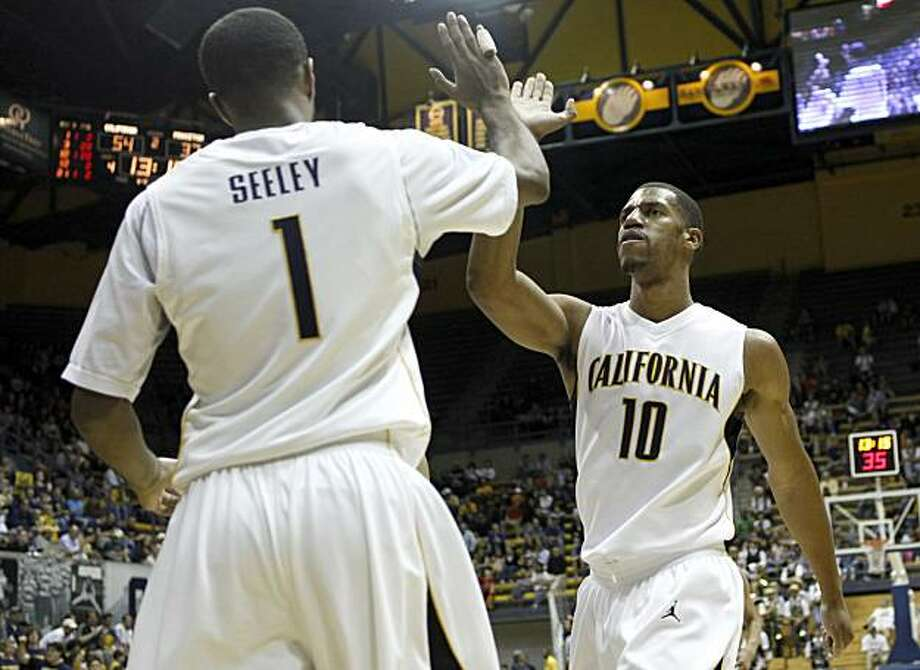 California's D.J. Seeley (1) and Jamal Boykin celebrate in the second half during an NCAA college basketball game against Princeton in Berkeley, Calif., Sunday, Nov. 29, 2009. California won 81-60. (AP Photo/Jeff Chiu) Photo: Jeff Chiu, AP