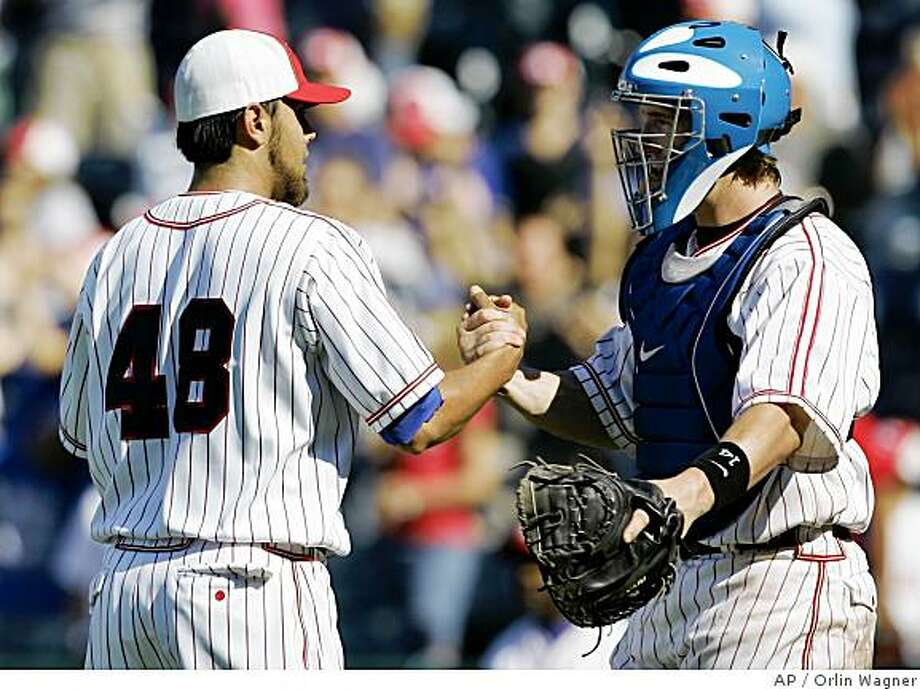 Kansas City Royals pitcher Joakim Soria (48) is congratulated by catcher John Buck following their 11-10 win over the San Francisco Giants in a major league baseball game in Kansas City, Mo., Sunday, June 22, 2008. Soria earned his 20th save of the season. Photo: Orlin Wagner, AP