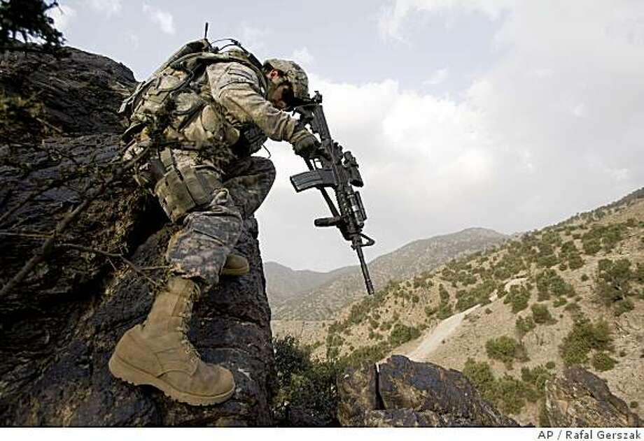 U.S. Army Lieutenant Gabriel Stultz from the 101st Airborne Division, 506th Infantry Regiment, 2nd Battalion, 4th Platoon, climbs down a mountain while on patrol in search of Taliban forces in Khost province, south of Kabul, Afghanistan, Monday, June 9, 2008. (AP Photo/Rafal Gerszak) Photo: Rafal Gerszak, AP