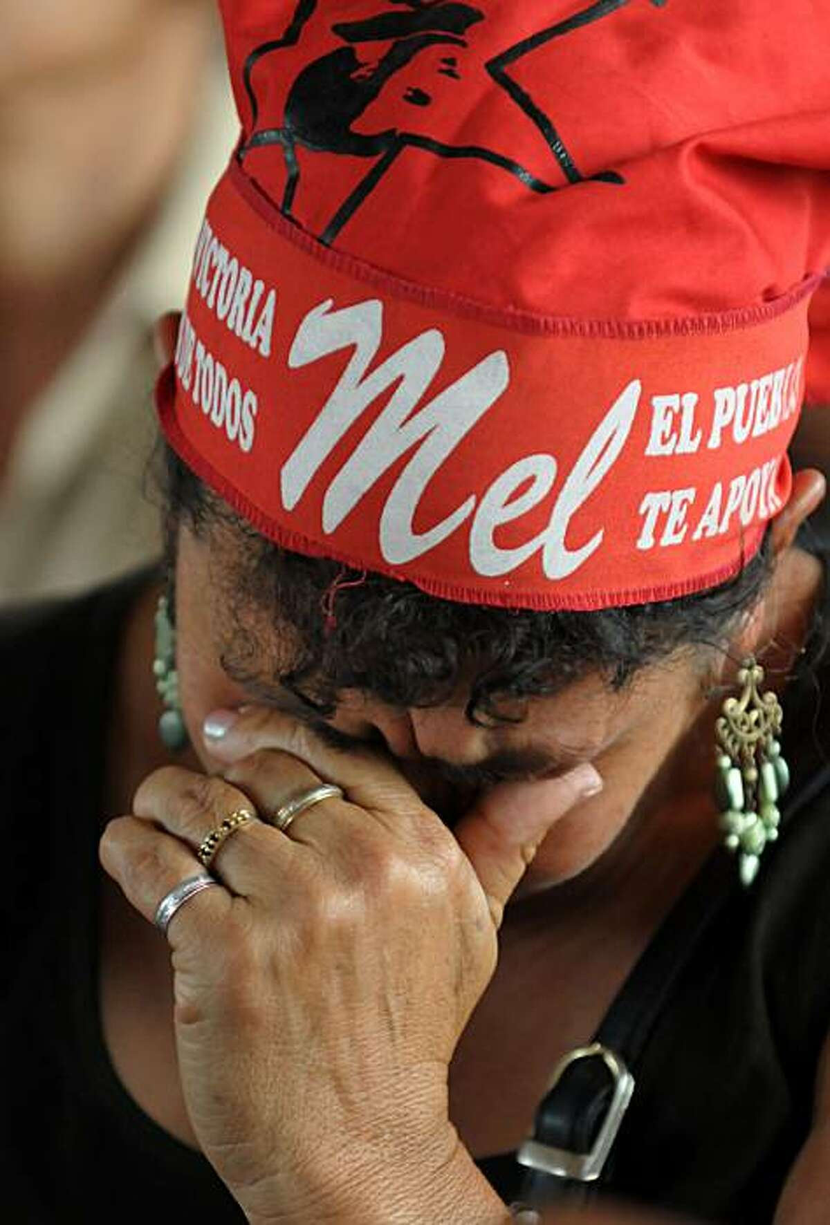 A supporter of ousted Honduran President Manuel Zelaya cries during meeting of the National Front of Resistance against the Coup in Tegucigalpa on December 3, 2009. Honduran lawmakers late Wednesday roundly rejected the reinstatement of ousted President Manuel Zelaya during a heated debate revisiting details of the June 28 coup which polarized the nation. The vote came as Honduras was in limbo, three days after conservative Porfirio Lobo won a controversial presidential election held under the de facto regime. TOPSHOTS/AFP PHOTO/Orlando SIERRA (Photo credit should read ORLANDO SIERRA/AFP/Getty Images)