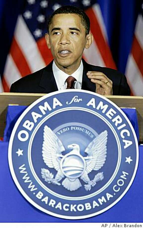 """Democratic presidential candidate Sen. Barack Obama, D-Ill., speaks during a meeting of Democratic Governors at the Chicago History Museum in Chicago Friday, June 20, 2008. A new seal debuted on Obama's podium Friday, sporting iconography used in the U.S. presidential seal, the blue background, the eagle clutching arrows on left and olive branch on right, but with symbolic differences.  Instead of the Latin """"E pluribus unum"""" (Out of many, one), Obama's says """"Vero possumus"""", rough Latin for """"Yes, we can."""" Instead of """"Seal of the President of the United States"""", Obama's Web site address is listed.  And instead of a shield, Obama's eagle wears his """"O"""" campaign logo with a rising sun representing hope ahead.   (AP Photo/Alex Brandon) Photo: Alex Brandon, AP"""