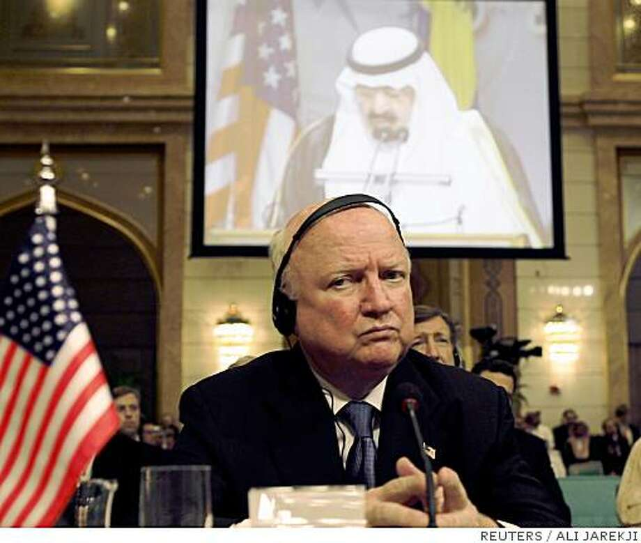 U.S. Secretary of Energy Samuel Bodman listens to Saudi King Abdullah speak during the opening ceremony of the Jeddah Energy Meeting June 22, 2008.  The world's largest oil exporter Saudi Arabia on Sunday proposed setting up a $1 billion OPEC fund and offered $500 million in Saudi soft loans to help poor countries cope with the high price of energy.  REUTERS/Ali Jarekji (SAUDI ARABIA) Photo: ALI JAREKJI, REUTERS