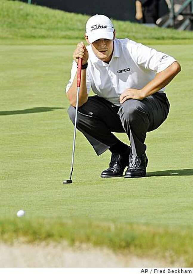 Johnson Wagner reads his putt on the ninth hole in the first round of the Travelers Championship in Cromwell, Conn., on Thursday, June 19, 2008. Wagner ended the round tied for first at 6-under par. Photo: Fred Beckham, AP