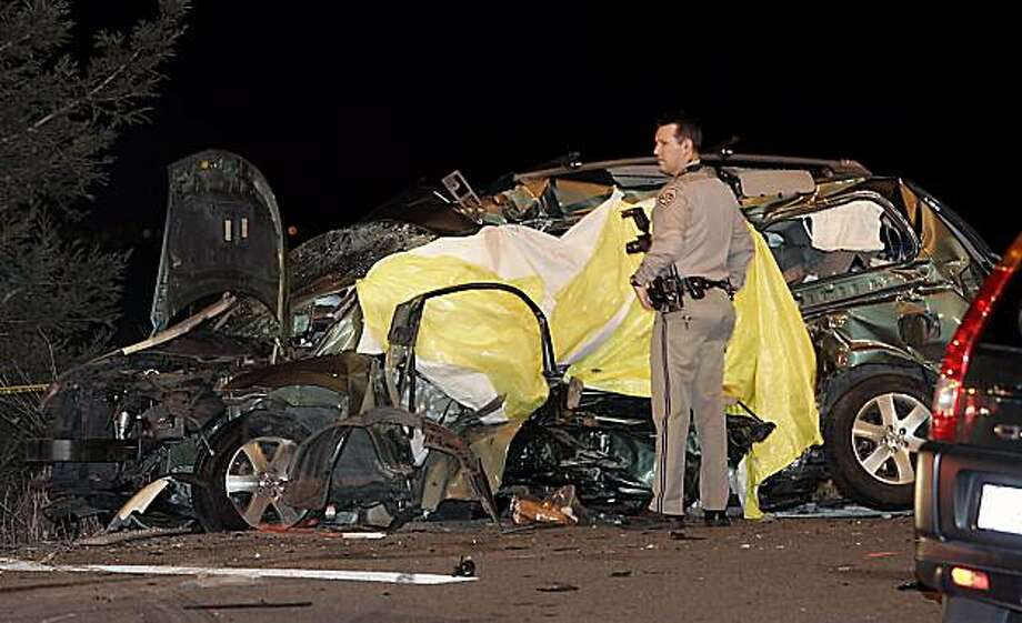 A CHP officer stands next to a Nissan Quest that was involved in a quadruple fatal accident with a mini cooper at HWY 37 and Lakeville HWY at around 9pm on Saturday night November 28, 2009. Scott Manchester / The Press Democrat