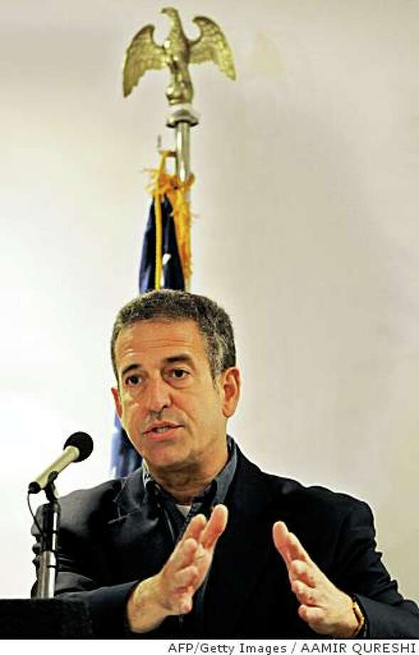 "US Senator Russell D. Feingold gestures as he addresses a news conference in Islamabad on May 28, 2008.  Feingold called for ""immediate"" restoration of Pakistani judges deposed by embattled President Pervez Musharraf. Musharraf sacked the country's chief justice Iftikahr Muhammad Chaudhry and dozens of other judges under a state of emergency in November, when it appeared that the Supreme Court was about to overturn his re-election as president the month before.  AFP PHOTO/Aamir QURESHI (Photo credit should read AAMIR QURESHI/AFP/Getty Images) Photo: AAMIR QURESHI, AFP/Getty Images"