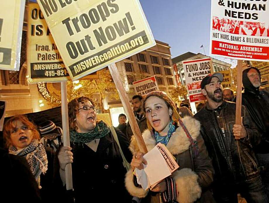 Protesters like Desiree Aubry (right center) attended the first anti-war protest since the Obama speach. About two hundred people against the President's policies in Afghanistan and actions in the Middle East held a rally at Powell and Market Streets and marched around the area Wednesday December 2, 2009. Photo: Brant Ward, The Chronicle