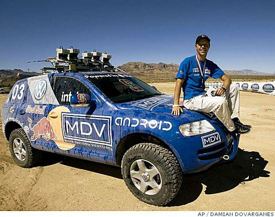 Meanwhile, Stanford University's ?Stanley? ? the robo-car that won a 2005 sprint across the Mojave Desert ? is making a month-long pit stop at the Tech Museum of Innovation in San Jose before going on display at the Smithsonian Institution in Washington, D.C Photo: DAMIAN DOVARGANES, AP