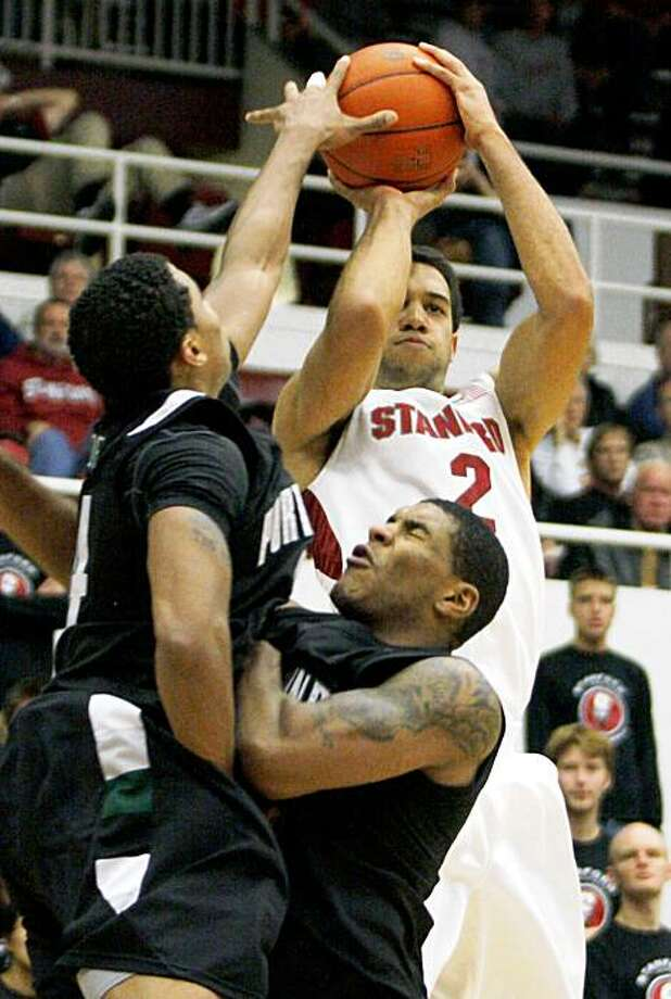 Stanford's Landry Fields (2) shoots in front of Portland State's Jamie Jones, left, and Julius Thomas in the second half of an NCAA college basketball game Sunday, Nov. 29, 2009, in Stanford, Calif. Stanford beat Portland State 83-64. (AP Photo/George Nikitin) Photo: George Nikitin, AP