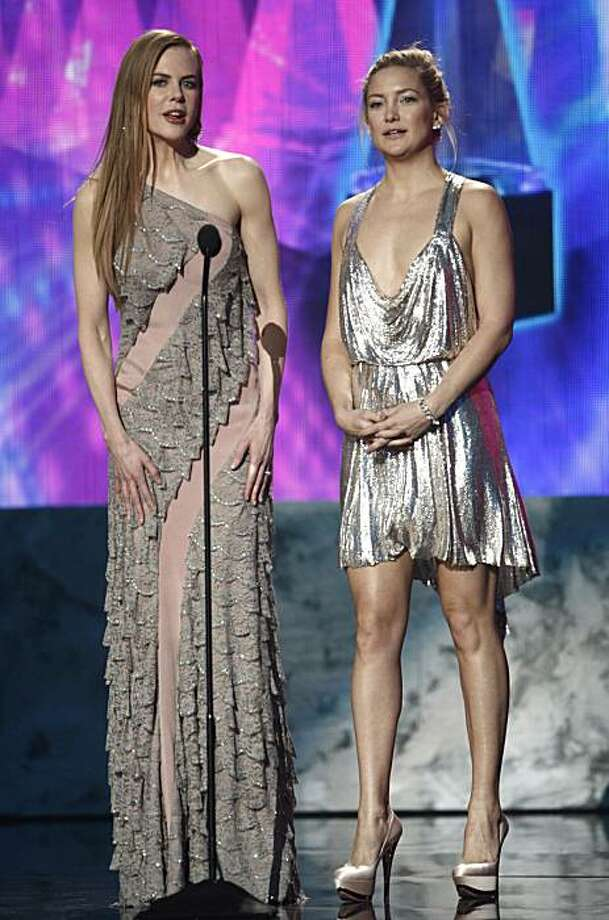 Nicole Kidman, left, and Kate Hudson are seen on stage at the 37th Annual  American Music Awards on Sunday, Nov. 22, 2009, in Los Angeles. (AP Photo/Matt Sayles) Photo: Matt Sayles, AP