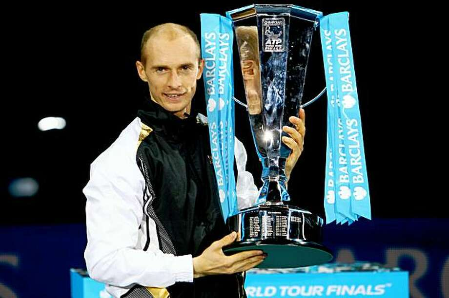 LONDON, ENGLAND - NOVEMBER 29:  Nikolay Davydenko of Russia holds the trophy as he celebrates winning the men's singles final match against Juan Martin Del Potro of Argentina during the Barclays ATP World Tour Finals at the O2 Arena on November 29, 2009 in London, England.  (Photo by Julian Finney/Getty Images) Photo: Julian Finney, Getty Images