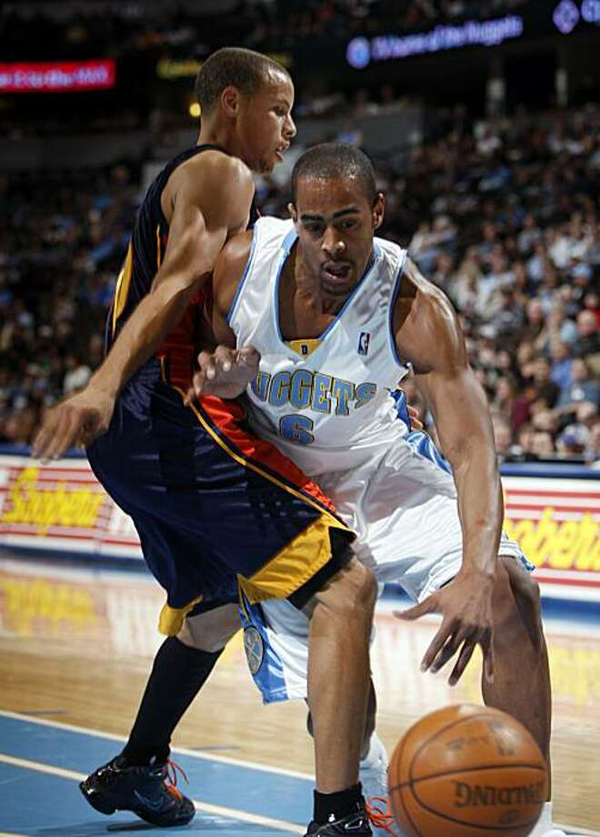 Denver Nuggets guard Arron Afflalo, right, loses control of the ball while trying to pass by Golden State Warriors guard Stephen Curry in the first quarter in Denver on Tuesday. Photo: David Zalubowski, AP