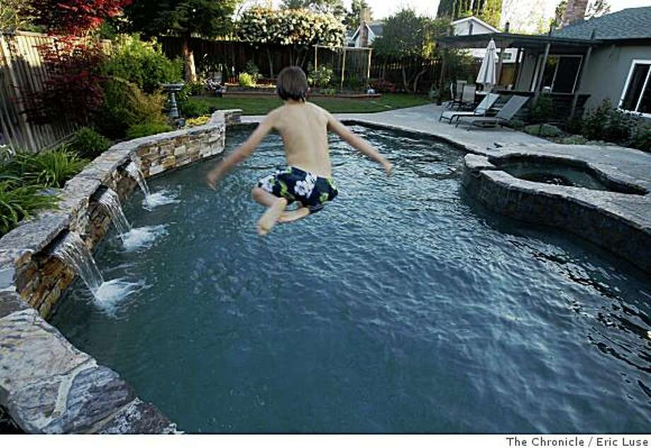 Everett Rubin,13, works on his canon ball technique in the family pool. Their home is in Pleasant Hill photographed on Tuesday, April 15, 2008Photo by Eric Luse /  San Francisco Chronicle Photo: Eric Luse, The Chronicle