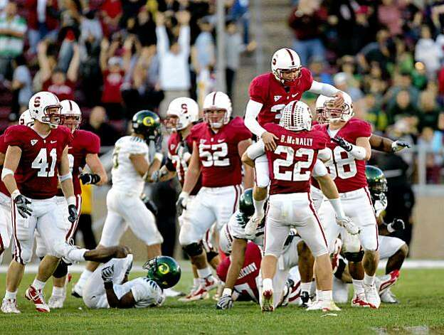 PALO ALTO, CA - NOVEMBER 07:  Nate Whitaker #39 of the Stanford Cardinal jumps in to the arms of Bo McNally #22 after Whitaker kicks a field goal that clinched their upset win over the Oregon Ducks at Stanford Stadium on November 7, 2009 in Palo Alto, California.  (Photo by Ezra Shaw/Getty Images) Photo: Ezra Shaw, Getty Images