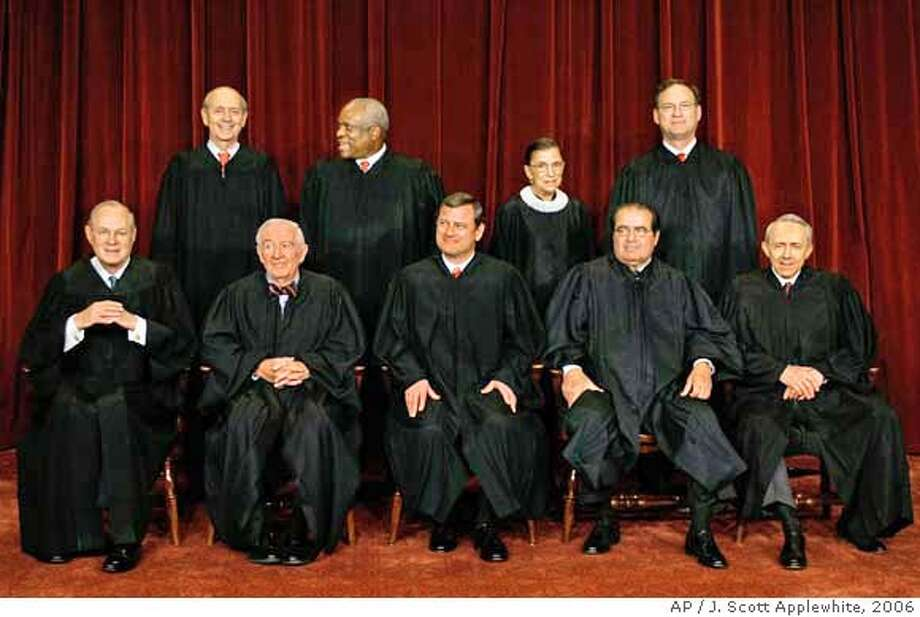 ** FILE ** With the addition of the Supreme Court's newest member, Justice Samuel Alito Jr., top row at right, the high court sits for a new group photograph in this March 3, 2006, file photo, at the Supreme Court Building in Washington. Seated in the front row, from left to right are: Associate Justice Anthony M. Kennedy, Associate Justice John Paul Stevens, Chief Justice of the United States John G. Roberts, Associate Justice Antonin Scalia, and Associate Justice David Souter. Standing, from left to right, in the top row, are: Associate Justice Stephen Breyer, Associate Justice Clarence Thomas, Associate Justice Ruth Bader Ginsburg, and Associate Justice Samuel Alito Jr. The Supreme Court is set to begin a term in the fall of 2007, that could lead to enhanced rights for terrorism detainees, a ruling against part of a child pornography law and shorter prison terms for crack cocaine dealers.(AP Photo/J. Scott Applewhite, File) A MARCH 3, 2006 FILE PHOTO Photo: J. SCOTT APPLEWHITE
