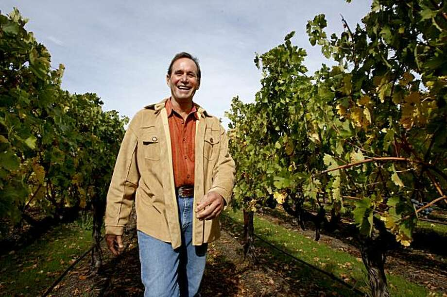 Andy Beckstoffer smiles as he walks through his To Kalon Vineyard, which yields some of the finest Cabernet Sauvignon grapes in the Napa Valley. Andy Beckstoffer, founder of Beckstoffer Vineyards in Rutherford, CA has donated his 90-acre To Kalon Vineyard as a conservation easement, which means the land can never be developed. Photo: Brant Ward, The Chronicle