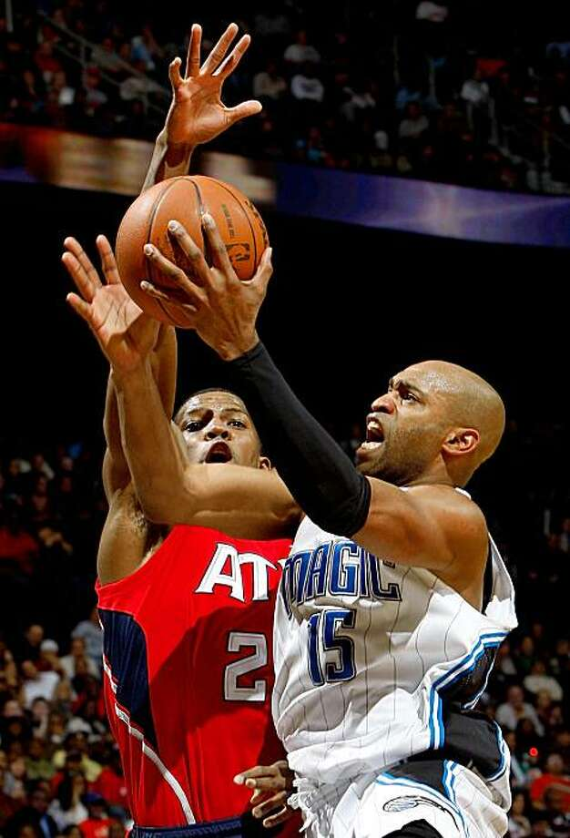 ATLANTA - NOVEMBER 26:  Vince Carter #15 of the Orlando Magic drives against Joe Johnson #2 of the Atlanta Hawks at Philips Arena on November 26, 2009 in Atlanta, Georgia.  (Photo by Kevin C. Cox/Getty Images) Photo: Kevin C. Cox, Getty Images