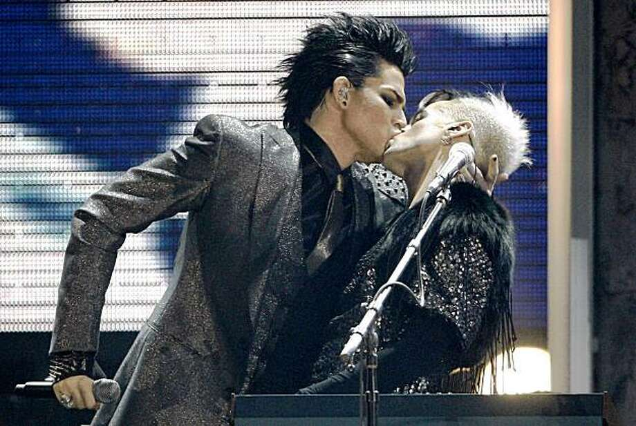 Adam Lambert, left, kisses one of the dancers as he performs during the closing act of the 37th Annual American Music Awards on Sunday, Nov. 22, 2009, in Los Angeles. (AP Photo/Matt Sayles) Photo: Matt Sayles, AP