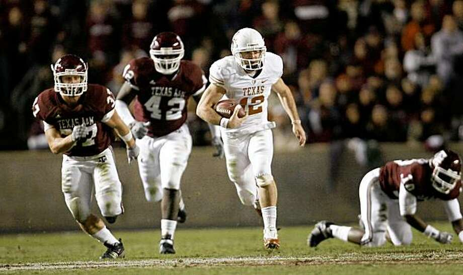COLLEGE STATION, TX - NOVEMBER 26: Quarterback Colt McCoy #12 of the Texas Longhorns scrambles away from the Texas A&M Aggies defense to score a touchdown in the first half at Kyle Field on November 26, 2009 in College Station, Texas.  (Photo by Aaron M. Sprecher/Getty Images) Photo: Aaron M. Sprecher, Getty Images