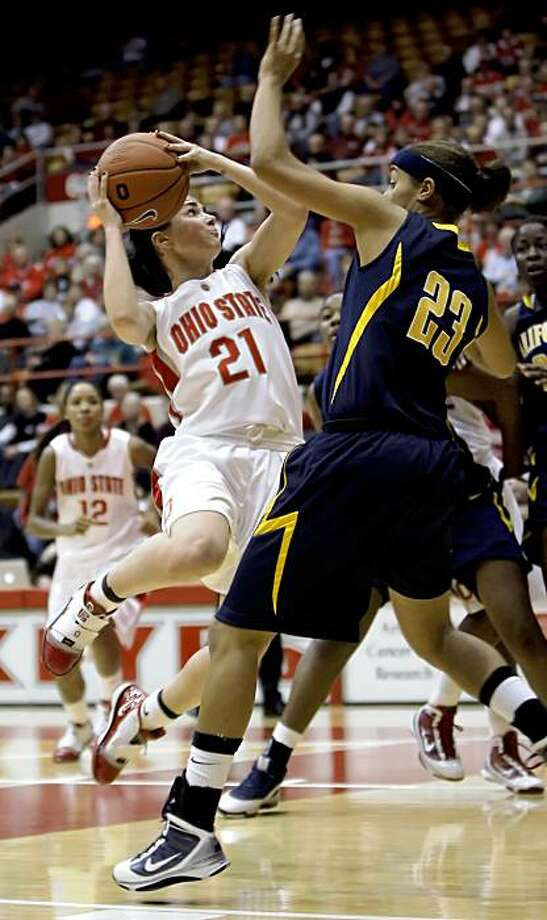 Ohio State's Samantha Prahalis, left, drives to the basket as California's Layshia Clarendon defends during the first half of an NCAA college basketball game Sunday, Nov. 29, 2009, in Columbus, Ohio. (AP Photo/Jay LaPrete) Photo: Jay LaPrete, AP