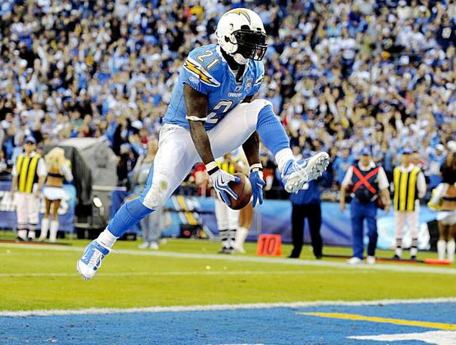San Diego Chargers running back LaDainian Tomlinson celebrates his second touchdown during the third quarter of an NFL football game against the Kansas City Chiefs, Sunday, Nov. 29, 2009, in San Diego. (AP Photo/Chris Carlson) Photo: Chris Carlson, AP