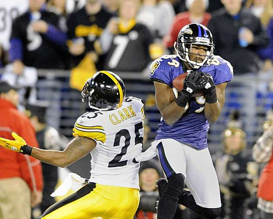 Baltimore Ravens wide receiver Mark Clayton, right, beats Pittsburgh Steelers defender Ryan Clark, and picks up 54 yards during second-quarter action at M&T Bank Stadium in Baltimore, Maryland, Sunday, November 29, 2009. (Gene Sweeney Jr./Baltimore Sun/MCT) Photo: Gene Sweeney Jr., MCT