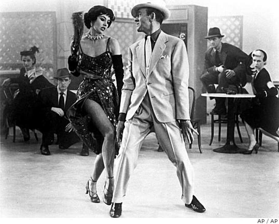 """** RETRANSMITTED VERSION OF NY115 ** In this undated file photo, Fred Astaire, right, and Cyd Charisse dance in the 1953 film """"The Band Wagon"""". Charisse, the long-legged Texas beauty who danced with the Ballet Russe as a teenager and starred in MGM musicals with Fred Astaire and Gene Kelly, died Tuesday, June 17, 2008. She was 86. (AP Photo) Photo: AP"""