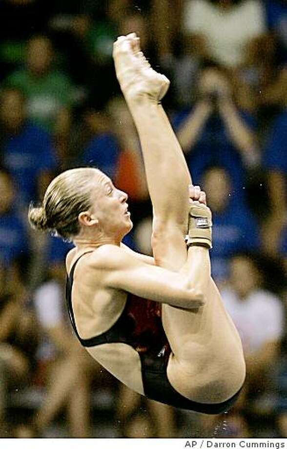 Laura Wilkinson performs a dive in the semifinals of the women's platform at the U.S Olympic diving trials in Indianapolis, Friday, June 20, 2008.  (AP Photo/Darron Cummings) Photo: Darron Cummings, AP