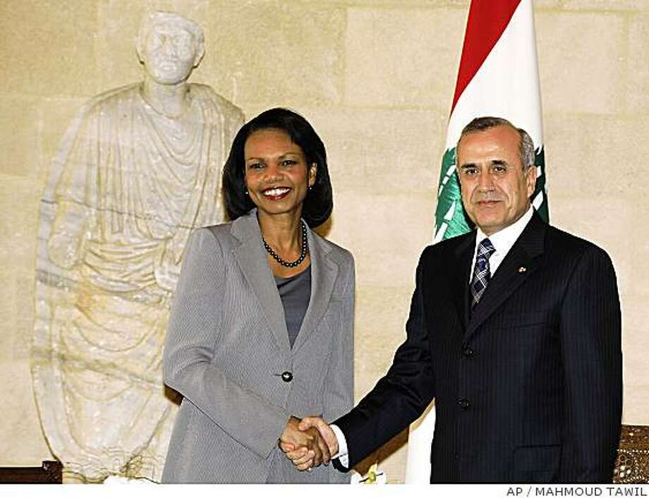Lebanese President Michel Suleiman, the army chief elected last month as president, right, shakes hands with U.S. Secretary of State Condoleezza Rice, left, at the presidential palace, in Beirut, Lebanon, Monday June 16, 2008. Rice put an American stamp of approval Monday on plans for a new government in Lebanon that would increase the power of Hezbollah militants. Rice made an unannounced visit to Lebanon's capital to meet with Western-backed leaders of an emerging coalition government, which the country's factions are still negotiating over. The U.S. regards Iranian- and Syrian-backed Hezbollah as a terrorist group and has no dealings with it. (AP Photo/Mahmoud Tawil) Photo: MAHMOUD TAWIL, AP