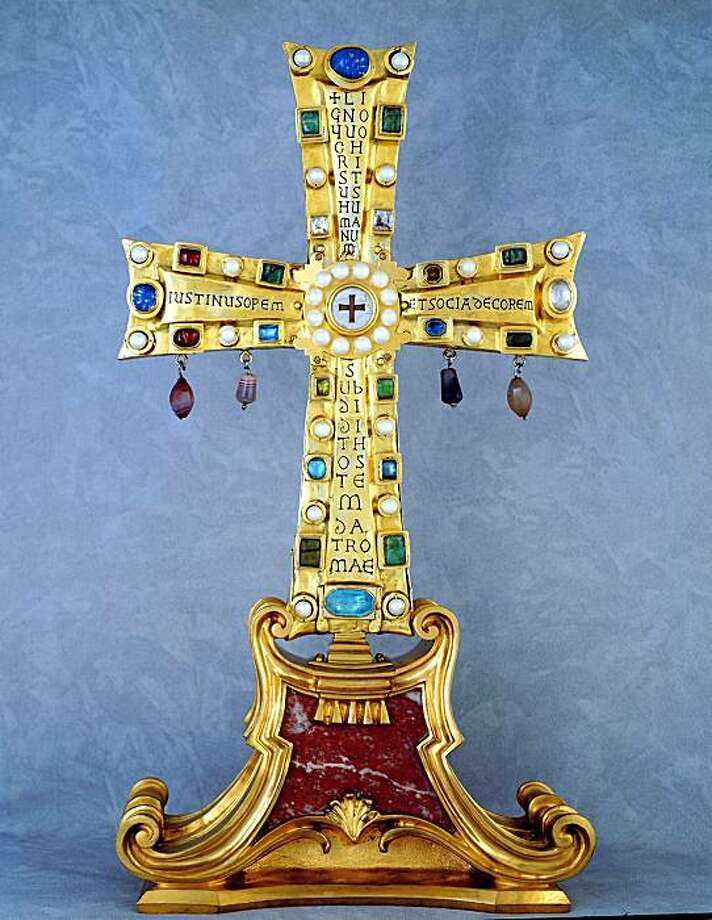 This photo provided Wednesday Nov. 18, 2009 by Ku.Ra Comunicazione agency shows the front of the restored Crux Vaticana (Vatican Cross), according to experts the oldest known reliquary containing the purported fragments of the cross on which Jesus was crucified. Experts said the Crux Vaticana has been restored to its Byzantine-era glory. The Vatican on Thursday will unveil the restored work, a gem-encrusted golden cross containing at its center what tradition holds are shards of Jesus' cross. (AP Photo/Ku.Ra Comunicazione) ** EDITORIAL USE ONLY ** Photo: AP