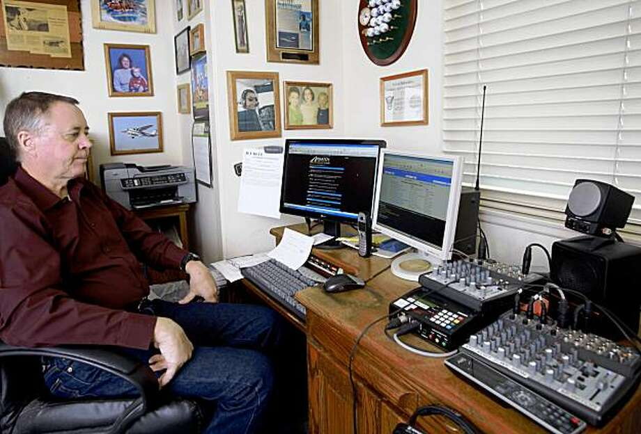 "In this Friday, Nov. 20, 2009 photo showing traffic watcher Mike Nolan working at his computers doing his radio traffic report from his home studio in Corona, Calif. For more than 20 years, Nolan was known to radio listeners as the ""eye in the sky."" He flew over Southern California freeways in his single-engine plane, spying the worst traffic in the nation. These days, he sends his reports from his home office in suburban Los Angeles. (AP Photo/Damian Dovarganes) Photo: Damian Dovarganes, AP"