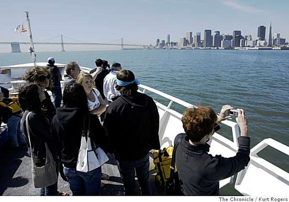 Alisa Huntsman from Nashville  TN  take ing photos of San Francisco   she took the round trip on the ferry this morning. As part of the Bay Area's Spare the Air Free Ride Day the Ferry's were free till noon. on Thursday, June 19,  2008 in San Francisco , Calif  Photo by Kurt Rogers / The Chronicle. Photo: Kurt Rogers, The Chronicle