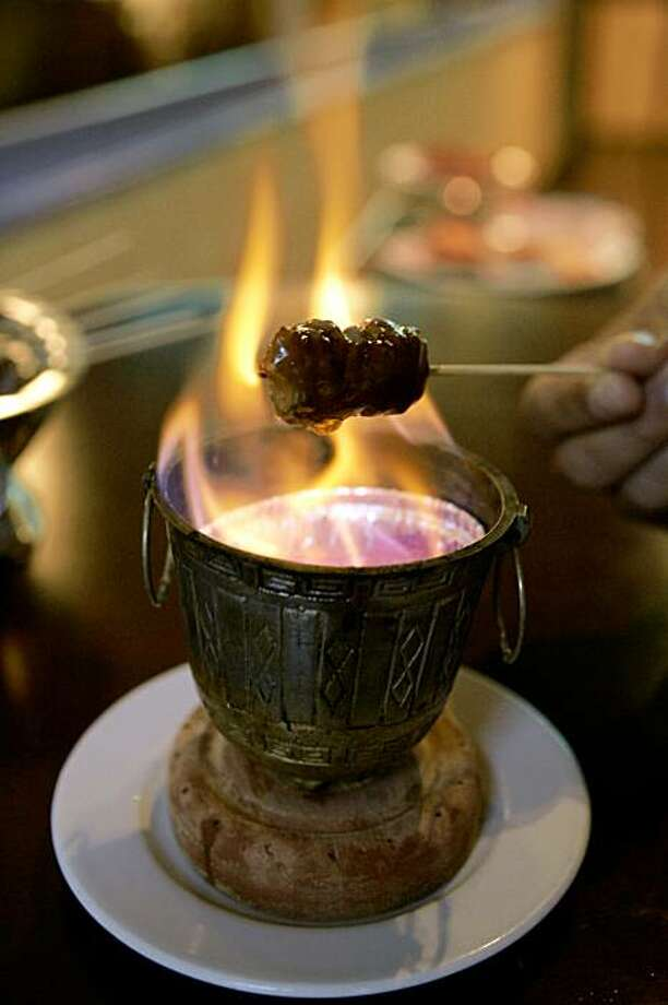 Cook your own food at Trader Vics in Emeryville. Photo: Deanne Fitzmaurice, SFC