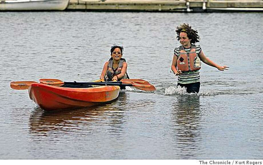 Maya Reinganum 9 and Mirabel Levine  10 of Mill Valley on their first day of summer vacation enjoy the water at Schoonmaker Point Marina   on Thursday, June 19,  2008 in Sausalito  , Calif  Photo by Kurt Rogers / The Chronicle. Photo: Kurt Rogers, The Chronicle