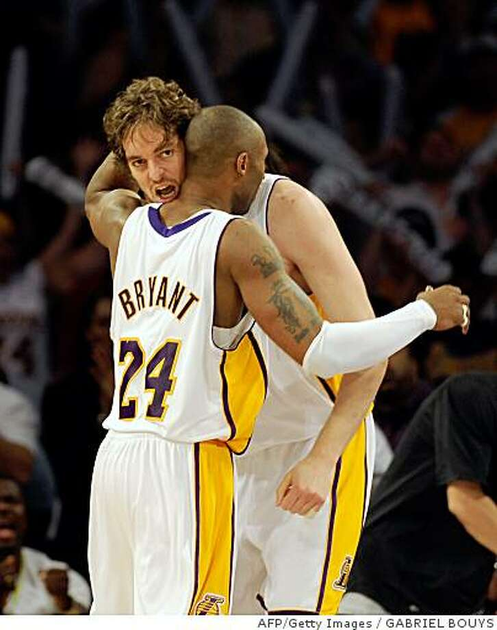 Los Angeles Lakers' Kobe Bryant hugs his teammate Pau Gasol from Spain, during the Game 5 of the 2008 NBA Finals, in Los Angeles, California, June 15, 2008. Lakers won the game 103 - 98, the Celtics leads the series 3-2. AFP PHOTO GABRIEL BOUYS (Photo credit should read GABRIEL BOUYS/AFP/Getty Images) Photo: GABRIEL BOUYS, AFP/Getty Images