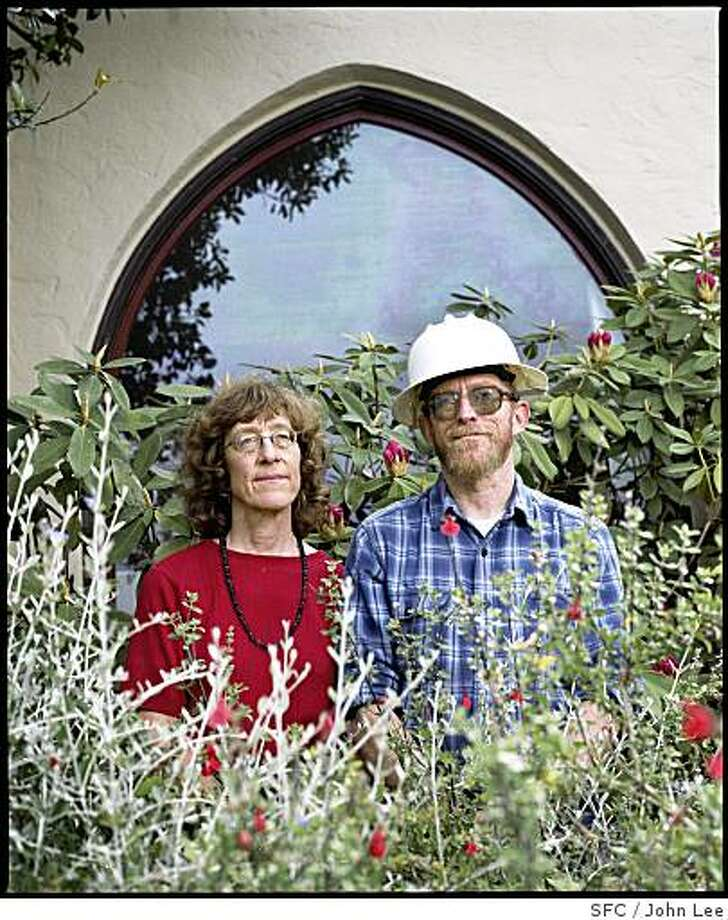 "MAG_GREEN22_01_JOHNLEE.JPG BERKELEY, CA - MAY 24:  Liz Varnhagen (cq), left, and her husband Steve Greenberg (cq), standing in the front yard of their Berkeley home, the ""Ordway Power Station.""  For Sam Whiting story.BY JOHN LEE / SPECIAL TO THE CHRONICLE Photo: John Lee, SFC"