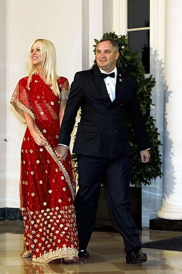 FILE - In this Tuesday, Nov. 24, 2009  file photo, Michaele and Tareq Salahi, right, arrive at a State Dinner hosted by President Barack Obama for Indian Prime Minister Manmohan Singh at the White House in Washington. This time, the picture is the story. After the Secret Service insisted that President Barack Obama was never endangered by a security breach that allowed a couple to crash his first state dinner, the White House has released a photo showing that not only did the pair get close to Obama, they actually shook hands and talked to him. (AP Photo/Gerald Herbert, file) Photo: Gerald Herbert, AP