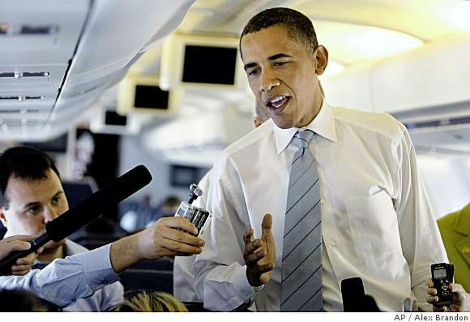 Democratic presidential candidate Sen. Barack Obama, D-Ill., talks to the media during a news conference on his campaign plane en route from Michigan to Washington, DC Tuesday, June 17, 2008.(AP Photo/Alex Brandon) Photo: Alex Brandon, AP