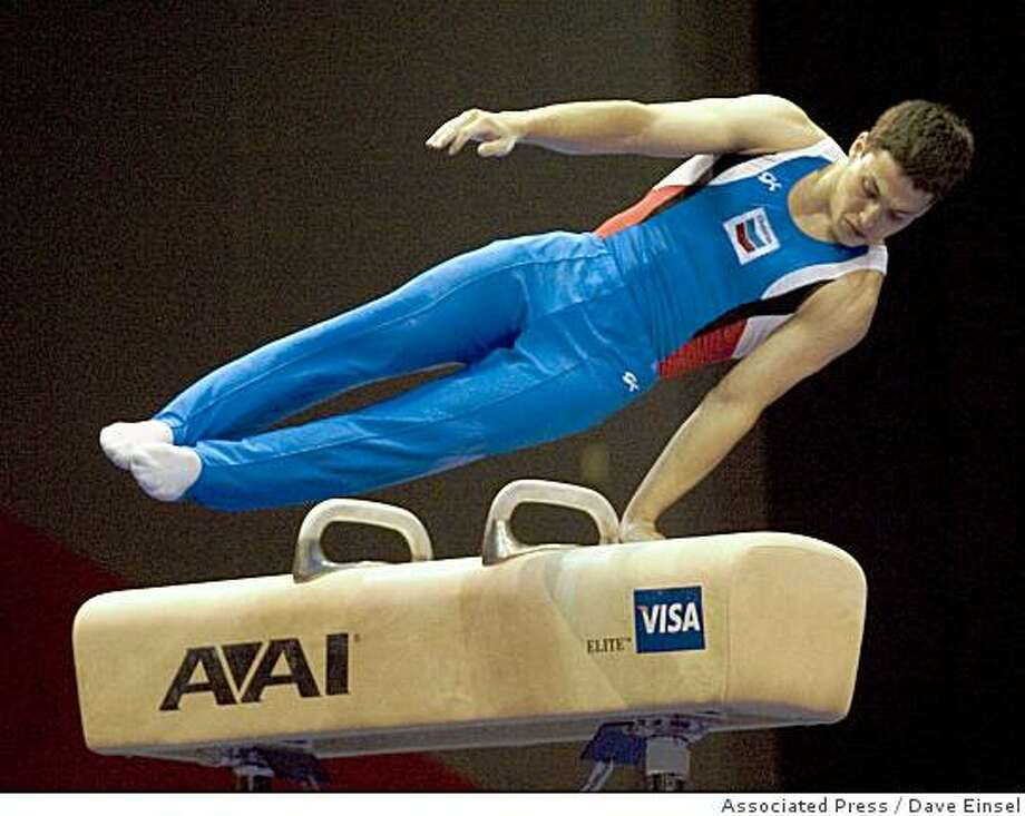 David Sender competes on the pommel horse during the final round of the US Gymnastics Championships Saturday, May 24, 2008 in Houston. Sender won the overall title with a score of 180.70. (AP Photo/Dave Einsel) Photo: Dave Einsel, Associated Press