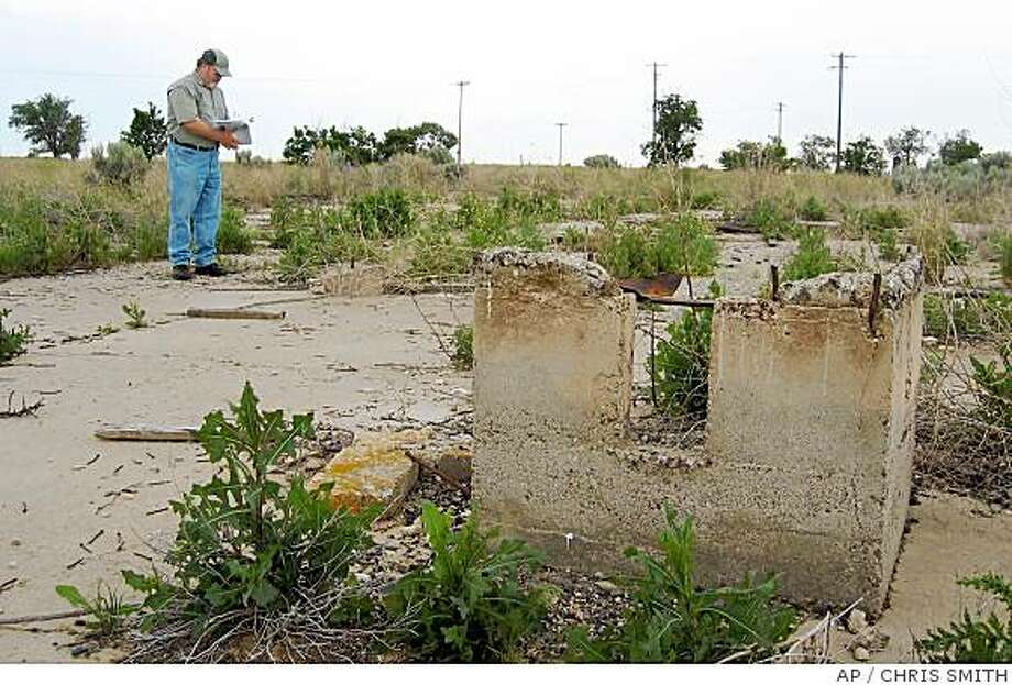 ** FILE ** In this June 13, 2006 file photo, Minidoka Internment National Monument superintendent Neil King is shown surveying the remnants of a warehouse at the monument, at Hunt, Idaho. The Friends of Minidoka nonprofit group is pushing to bring a comprehensive history of the World War II internment camp into Idaho public schools. An estimated 10,000 Japanese Americans were detained at the site during World War II. (AP Photo/Chris Smith, File) Photo: CHRIS SMITH, AP